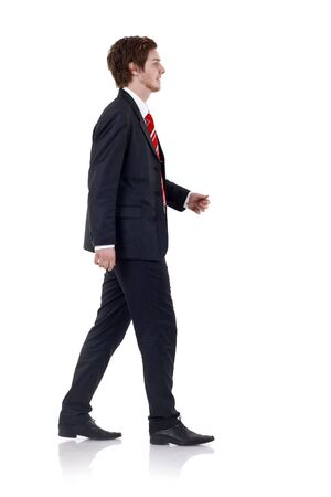 Happy  businessman walking in front of the camera isolated on white background