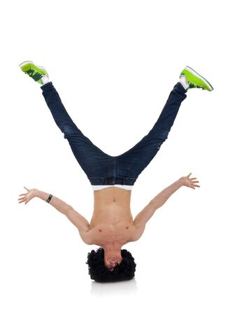 hip hop dancer: b-boy freeze on head. isolated on white  Stock Photo