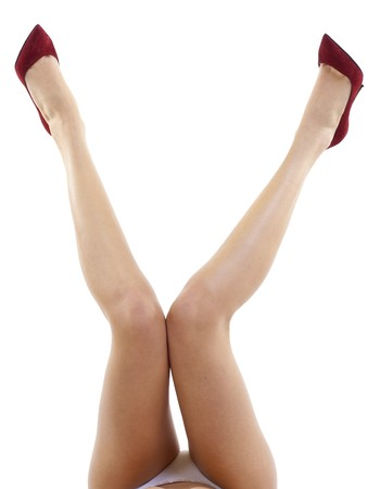 woman legs: Sexy attractive female legs up with high heels isolated over white background