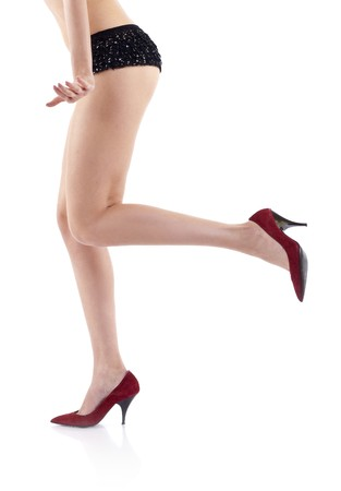 picture of a sexy woman's leg wearing fashion red shoes Stock Photo - 6990082
