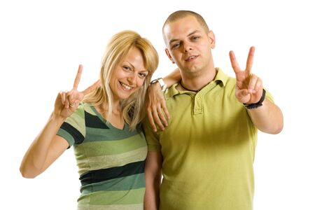 couple making their victory sign over white background photo