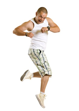 Excited young man jumping and smiling isolated on white photo