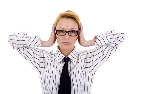 young businesswoman covers her ears with her hands looking worried