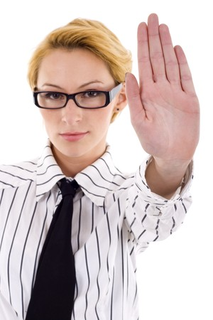 Serious businesswoman making stop sign over white, focus on hand Stock Photo - 6969961