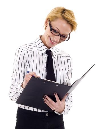questionaire: Empresaria escribiendo en un Portapapeles, aislado en un fondo blanco.  Foto de archivo