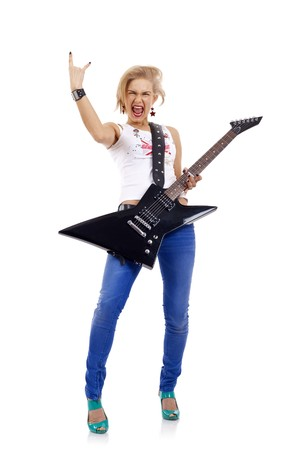 passionate woman guitarist playing the guitar and making a rock sign