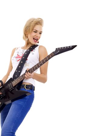 picture of a beautiful girl guitarist looking to a side Stock Photo - 6969933