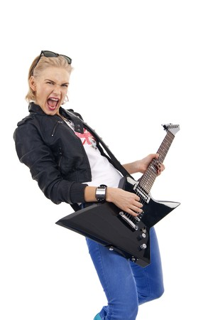 Fashion girl with guitar playing over white background  photo