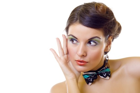 closeup of a beautiful woman wearing a green neck bow and beautiful makeup  photo