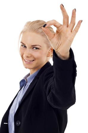 Attractive businesswoman satisfied with results - ok sign - focus on the hand Stock Photo - 7059012