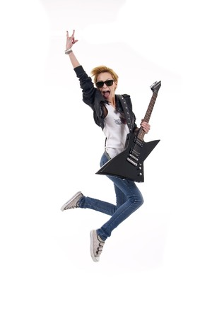 woman guitarist jumps making rock sign over white Stock Photo - 7058864
