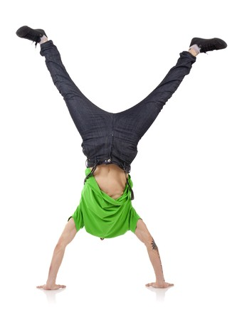 upside down: Young bboy standing on hands. Holding legs in air. Stock Photo
