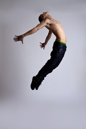 leap: stylish and young modern style dancer is posing