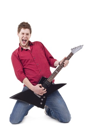 rockstar: excited young man playing a guitar isolated against white background