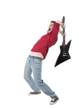 brak: studio shot pictures on isolated background of a angry man holding a guitar and trying to brak it