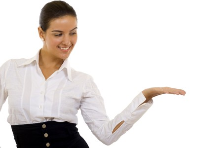Showing product. Beautiful young casual business woman or student presenting your product, holding out her hand  photo
