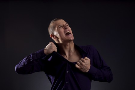 rips: smart casual man screaming and ripping his shirt  Stock Photo