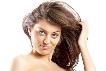 Front view of beauty and sexy woman with dark hair in the wind Stock Photo - 7132221
