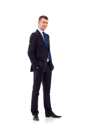 hands in pockets: Full length of a handsome business man standing with hands in pocket against white  Stock Photo