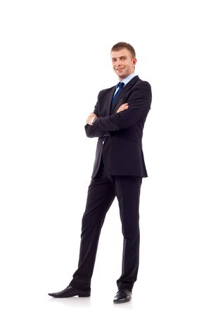 full body picture of a businessman with crossed hands standing against isolated white background