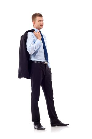 normal: Full length profile of a young business man with coat over shoulder against white