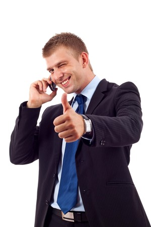 occupied: Handsome Corporate Man Being Positive On A Business Call and winking