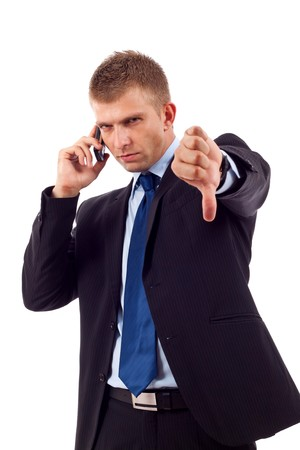 Businessman with bad news on his cell phone disapproving  Stock Photo - 7226861