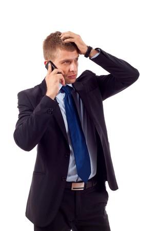 annoying: biznesmen na telefon ręką na głowie, otrzymujących bad news