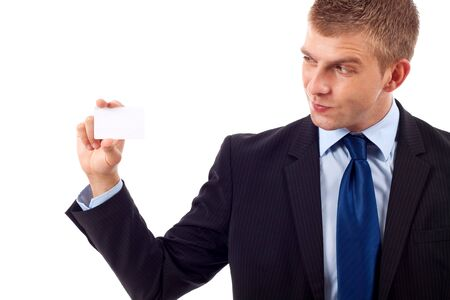 Business man holding a blank business card over white background Stock Photo - 7226863