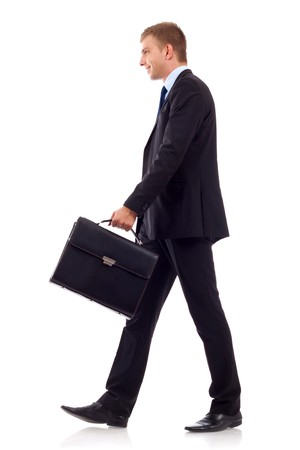 going business man holding brief case over wite  photo