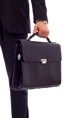 Low section image of a business person holding a suitcase  Stock Photo - 7235156