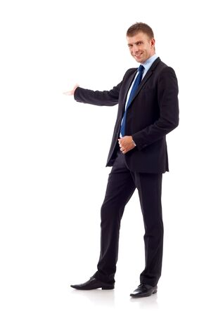 Happy business man presenting and showing with copy space for your text isolated on white background Stock Photo - 7226445