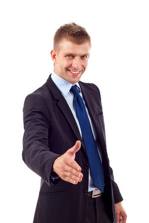 Businessman saying welcome and being ready to shake hands photo