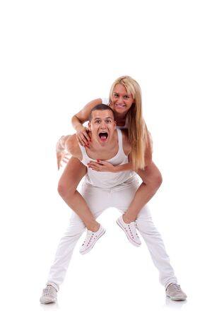 couple having fun over a white background  photo