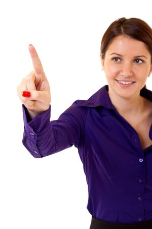 Brunette businesswoman touching virtual pad transparent key with finger  photo