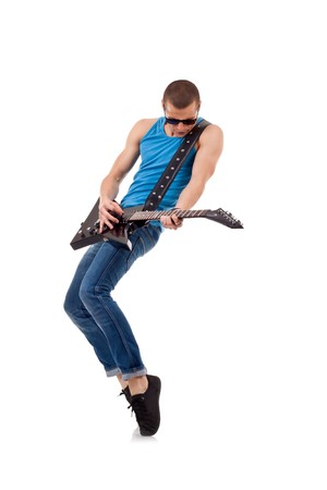 Guitar player with sunglasses playing his guitar on his tip toes  photo