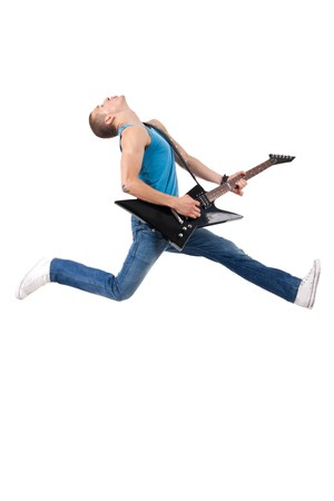 headbanging: Awesome guitar player jumps with passion in studio , over white