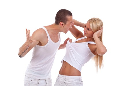 pulling hair: Domestic violence - picture of a man screaming and pulling his girlfriends shirt