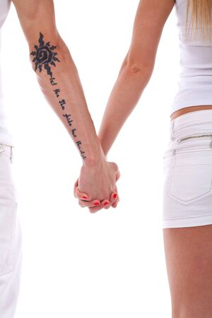 lovebirds: Young in love couple holding hands isolated on white  Stock Photo