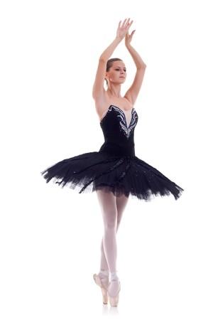 black swan: Professional ballet dancer isolated in studio , over white