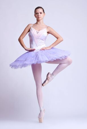 picture of a ballerina standing on one legs tip toe photo