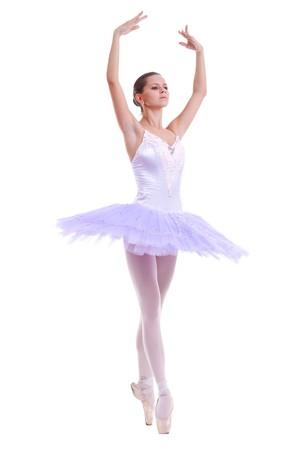 classical dance: beautiful ballerina dancer making a ballet pose over white
