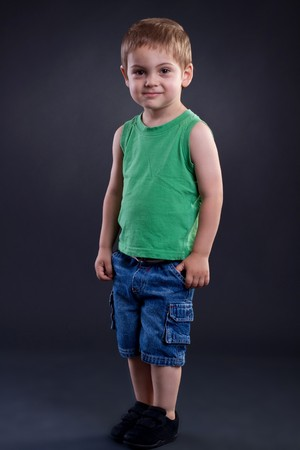 two years: Two years boy standing on a dark background