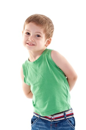 hands on pockets: picture of a small kid posing for the camera over white