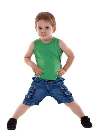 five year: preschool boy posing for kids fashion show over white