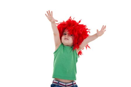 little party starter with hands up in the air - kid wearing a red feather wig photo