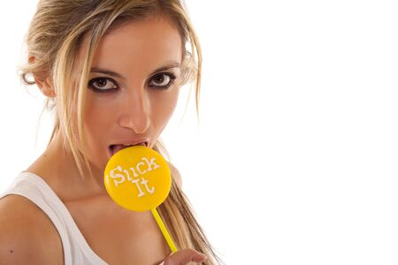A beautiful young model sucking on a yellow lollipop  photo