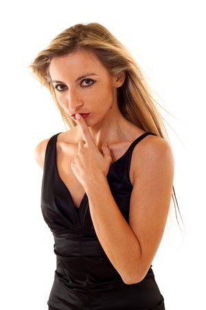 shushing: Young Woman Gesturing for Quiet or Shushing over white Stock Photo