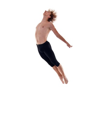 young modern dancer jumping over white background Stock Photo - 7564658