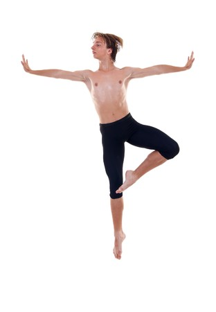 modern ballet dancer posing over white background - jumps in the air photo